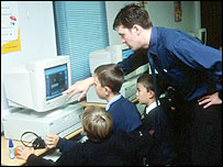 Male primary teacher working with students
